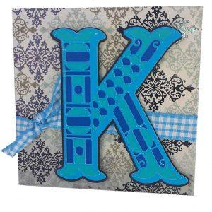 k card with monogram motifs