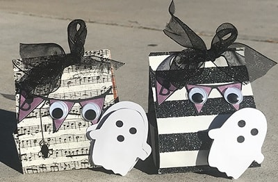 two ghost-themed halloween treat boxes
