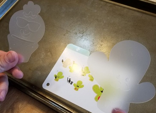 plastic templates for adding details to cookie cutter shapes