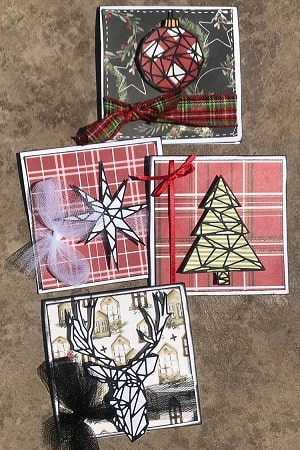 christmas cards made using the geo christmas thinlits die set