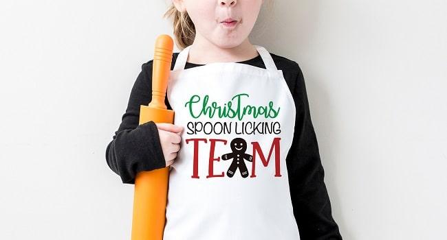 christmas spoon licking team apron design concept